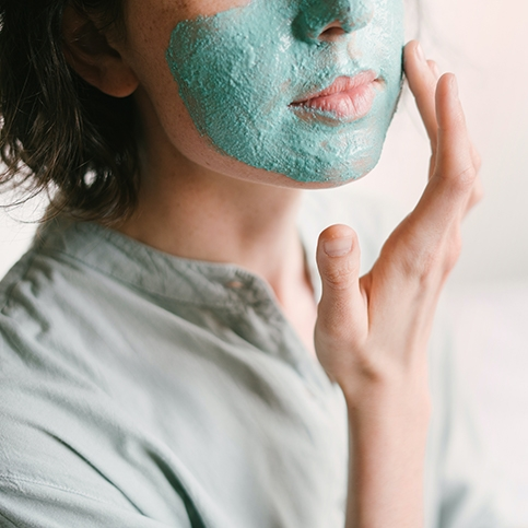 Woman taking care of her skin and needing a dermatologist visit.