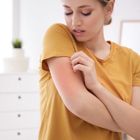 Woman needing to talk to a dermatologist about a rash on her arm.