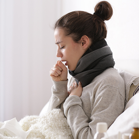 woman experiencing cold symptoms