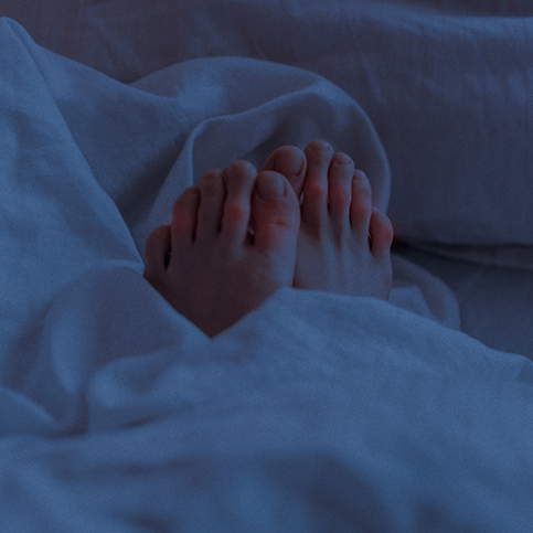 person with feet pain caused by gout