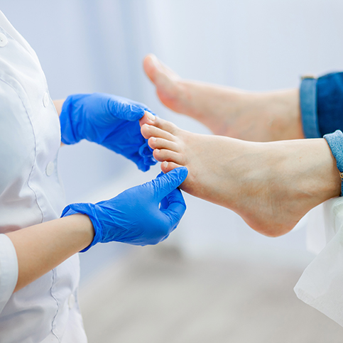 person receiving treatment for foot pain