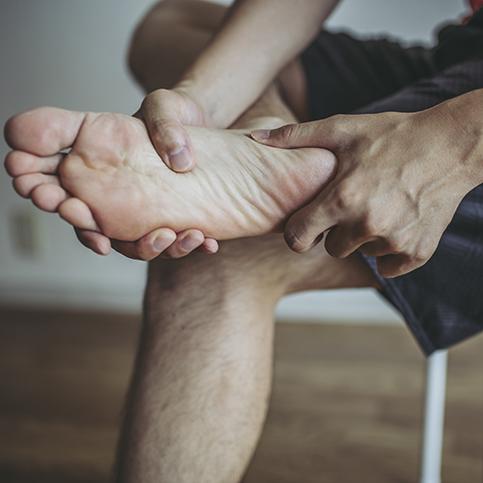 man experiencing foot pain