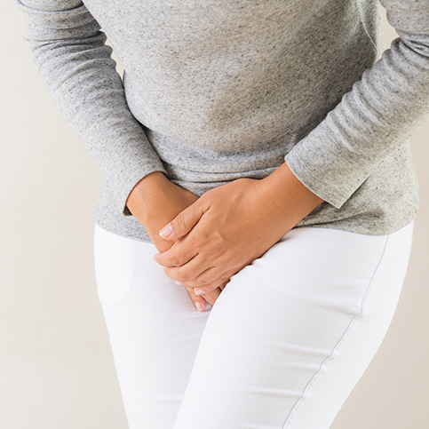 woman experiencing yeast infection symptoms